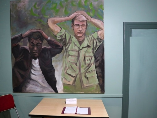 A painting depicts the takeover of the U.S. Embassy in Tehran in 1979. It shows U.S. Marine Sgt. Ladell Maples of Earle, Ark., left, and Cpl. Steve Kirtley of Little Rock, Ark., with their hands above their heads adorns a wall of the embassy, now partly a museum, in Tehran, Iran. Images like those of surrendering American troops carry a strong resonance for hard-liners in Iran. (Vahid Salemi/AP)