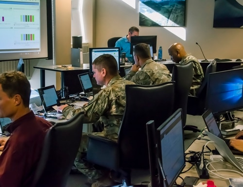 The services say in-house coders allow them to be more flexible during missions, rather than relying solely on contractor support to build cyber tools. (Maj. Darin Overstreet/U.S. Air National Guard)