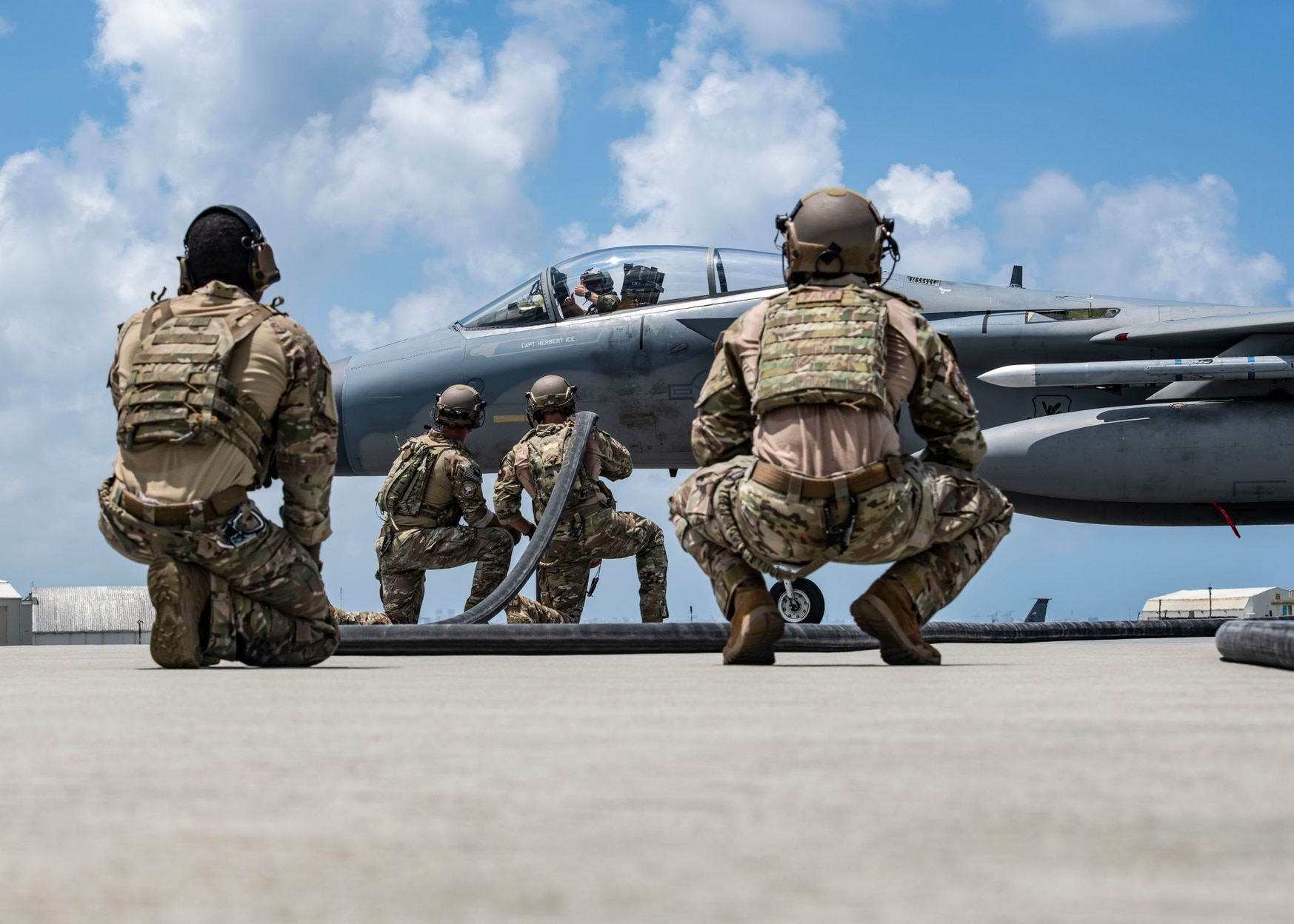 Airmen from the 353rd Special Operations Group prepare to refuel a U.S. Air Force F-15 Eagle during Exercise Westpac Rumrunner on July 31, 2020, at Kadena Air Base, Japan. The exercise was dedicated to implementing agile combat employment concepts. (Tech. Sgt. Micaiah Anthony/U.S. Air Force)