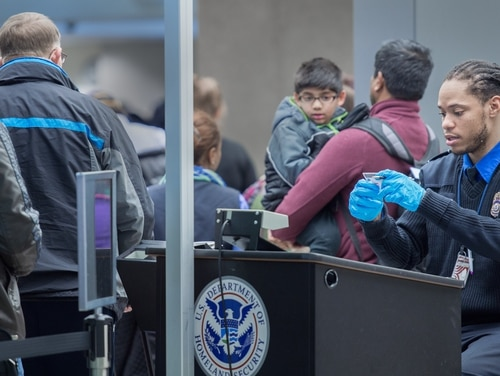Airline travelers are processed at a Transportation Safety Agency security checkpoint Dec. 23, 2014 at Dulles International Airport (IAD) in Sterling, Virginia. (Paul J. Richards/AFP/Getty Images)