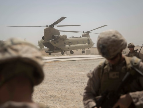 A Ch-47 Chinook lands to transport U.S. Marine advisers with Task Force Southwest after a train, advise and assist mission in Lashkar Gah, Afghanistan, July 9, 2017. (Sgt. Justin T. Updegraff/Marine Corps)