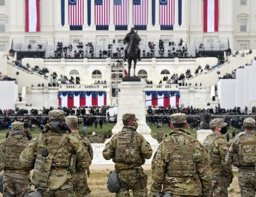 Members of the National Guard gather near the U.S. Capitol before the inauguration of President Joe Biden and Vice President-elect Kamala Harris on Jan. 20, 2021, in Washington. (Stephanie Keith/Getty Images)
