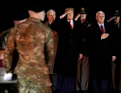 President Donald Trump and Vice President Mike Pence watch as a U.S. Army carry team moves a transfer case containing the remains of Sgt. 1st Class Javier Gutierrez, of San Antonio, Texas, Monday, Feb. 10, 2020, at Dover Air Force Base, Del. (Evan Vucci/AP)
