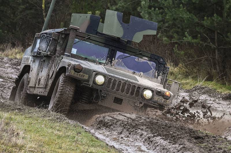 Soldiers maneuver a Humvee through a driver's training terrain course as part of the basic driving class at the 7th Army Training Command's Grafenwoehr Training Area, Germany, Jan. 9, 2018