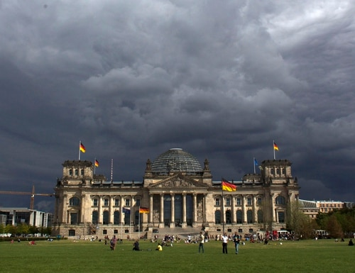 In this Aug. 20, 2013 file photo dark clouds hang over the Reichstag, the German parliament Bundestag building, in Berlin, Germany. German officials say there's no sign of concerted cyberattacks aimed at influencing the outcome of the country's upcoming election, but are warning against giving the all-clear yet. Interior Minister Thomas de Maiziere told German daily Bild on Wednesday, Sept. 20, 2017, that the
