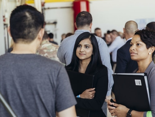 LinkedIn now provides one-year of free access to LInkedIn Premium to all military spouses -- including Coast Guard -- making a move, facing a job loss, or career change. The Here, a LinkedIn employee talks to military community members at a Hiring Our Heroes transition summit for service members, veterans and spouses, at Joint Base Lewis McChord in September, 2017. Photo courtesy of LinkedIn