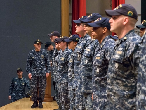 Vice Adm. Phil Sawyer, commander of U.S. 7th Fleet, awards the Navy and Marine Corps Commendation Medal to 36 crew members of the Arleigh Burke-class guided-missile destroyer Fitzgerald. (MC1 Leonard Adams/U.S. Navy)