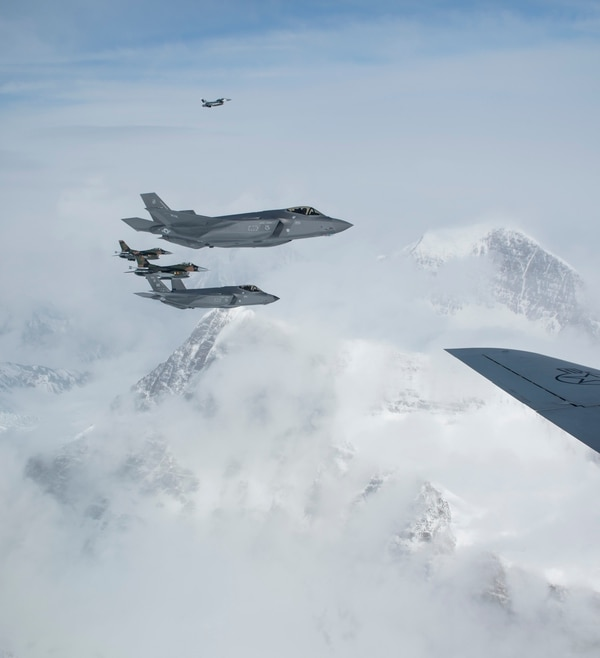 Two F-16C Fighting Falcons and two F-35A Lightning II aircraft from the 354th Fighter Wing of Eielson Air Force Base, Alaska, move into position to fly in formation off of a KC-135R Stratotanker from the 168th Wing, Alaska Air National Guard on April 21, 2020. (Tech. Sgt. Adam Keele/U.S. Air National Guard)