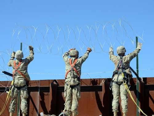 A team of soldiers attach a string of concertina wire to the border fence at San Luis, Ariz., March 14, 2019. (Sgt. 1st Class Ben K. Navratil/Army)
