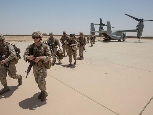 U.S. Marines debark from an MV-22B Osprey at Al Asad Air Base, Iraq, June 4, 2018. (Cpl. Jered T. Stone/Marine Corps)