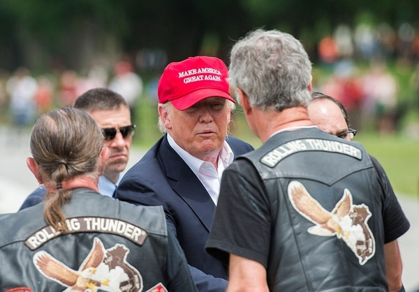 Republican presedential candidate Donald Trump shakes hands with veterans during the annual Rolling Thunder