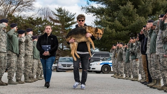 Members of the 436th Security Forces Squadron render a final salute to Rico, a retired military working dog. His former handler and current owner, retired Tech. Sgt. Jason Spangenberg, carried him to the Veterinary Treatment Facility at Dover Air Force Base, Del., Jan. 24, 2018. (Roland Balik/Air Force)