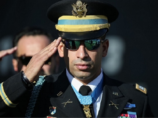 Medal of Honor recipient Capt. Florent Groberg stands for the national anthem before an NFL game in December 2015 in Chicago. Now retired, Groberg spoke to high school students on March 15 about leadership and ethics. (Photo by Jonathan Daniel/Getty Images)