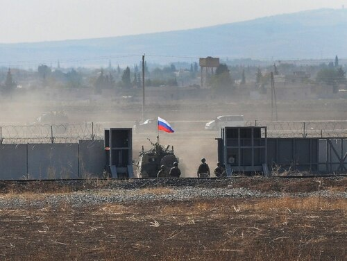 In this photo taken from the outskirts of Suruc, southeastern Turkey, a Russian army vehicle enters Syria, as it begins its joint patrol with Turkish forces on Nov. 5, 2019. (Mehmet Guzel/AP)