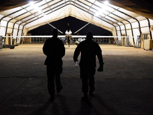 An MQ-9 Reaper deployed to Air Base 101 in Niamey, Niger, sits under a hangar. (Staff Sgt. Joshua Dewberry/Air Force)