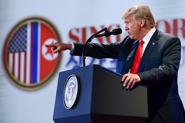 U.S. President Donald Trump answers questions about the summit with North Korea leader Kim Jong Un during a press conference at the Capella resort on Sentosa Island Tuesday, June 12, 2018, in Singapore. (Susan Walsh/AP)