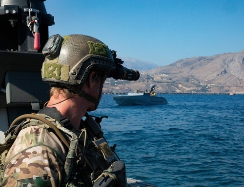 U.S. Naval Special Warfare operators and U.S. Navy Special Warfare combatant-craft crewmen prepare for a visit, board, search, and seizure exercise during a training mission at the NATO Maritime Interdiction Operational Training Center, Greece on July 31, 2020. (Sgt. Aven Santiago/Army)
