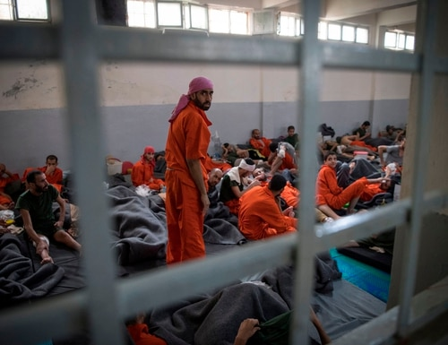 Men allegedly affiliated with the Islamic State group sit on the floor in a prison in the northeastern Syrian city of Hasakeh on Oct. 26, 2019.(Fadel Senna/AFP via Getty Images)