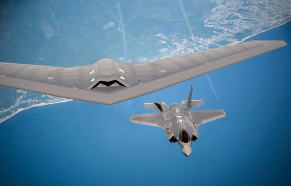 A rendering of Lockheed Martin's future UAV concept flying next to an F-35 fighter jet. (Lockheed Martin)