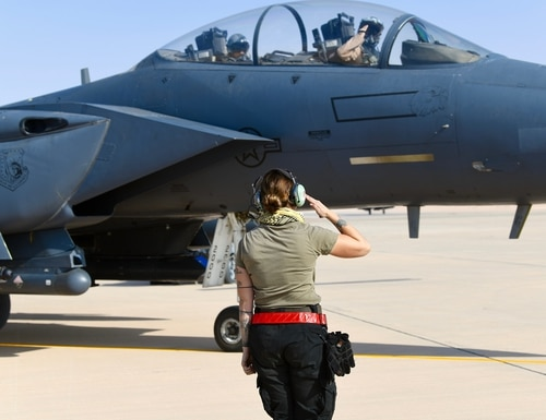 A crew chief with the 378th Expeditionary Maintenance Squadron salutes an F-15E Strike Eagle pilot prior to a sortie at Prince Sultan Air Base, Saudi Arabia, Jan. 8. The 494th Expeditionary Fighter Squadron completed the first combat sortie from PSAB since 2003. (Tech. Sgt. Michael Charles/Air Force)