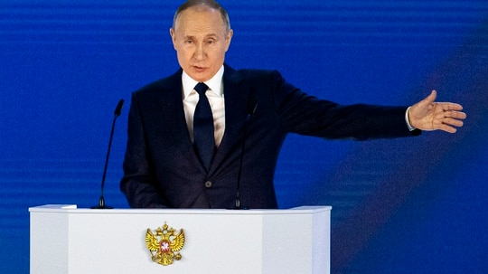 Russian President Vladimir Putin gestures as he gives his annual state of the nation address in Manezh, Moscow, April 21, 2021. (Alexander Zemlianichenko/AP)