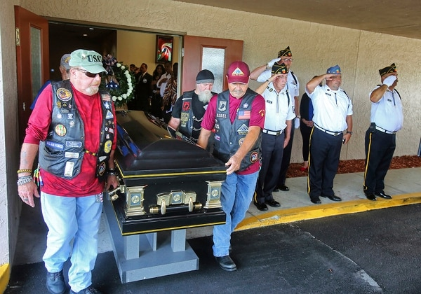 Motorcyclists from VFW Post 4287 and American Legion Post 155 present the casket of Stephen Jerald Spicer, a homeless U.S. Army veteran, during a full military honors service at Woodlawn Memorial Park in Gotha, Fla., July 18, 2019. (Joe Burbank/Orlando Sentinel via AP)