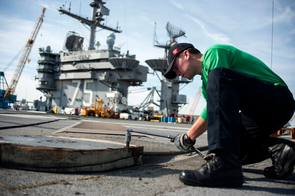 150515-N-OW828-014 PORTSMOUTH, Va. (May 15, 2015) Aviation Boatswain's Mate (Equipment) 2nd Class A.D. Larson performs maintenance on a retractable sheave aboard aircraft carrier USS Harry S. Truman (CVN 75). Truman is currently undergoing a condensed incremental availability period at Norfolk Naval Shipyard while training and acquiring certifications required for its upcoming deployment. (U.S. Navy photo by Mass Communication Specialist Seaman J. A. Mateo/Released)