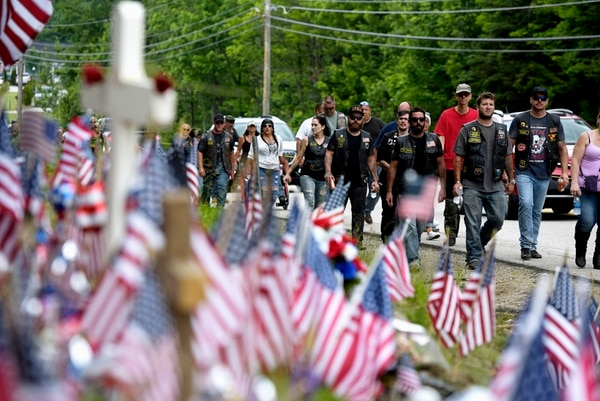 Motorcyclists participate in the Ride for the Fallen 7 on Saturday, July 6, 2019, in Randolph, N.H. Thousands of motorcyclists traveled through parts of New Hampshire as a tribute to the seven bikers killed in a collision with a pickup truck last month. (Paul Hayes/Caledonian-Record via AP)