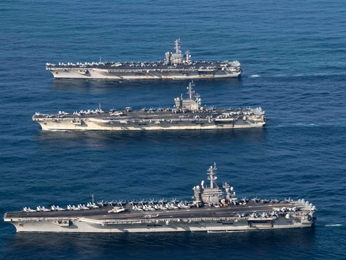 U.S. Navy aircraft carriers Ronald Reagan, Theodore Roosevelt and Nimitz conduct operations, in international waters as part of a three-carrier strike force exercise on Nov. 12, 2017. (Lt. j.g. James Griffin/U.S. Navy)