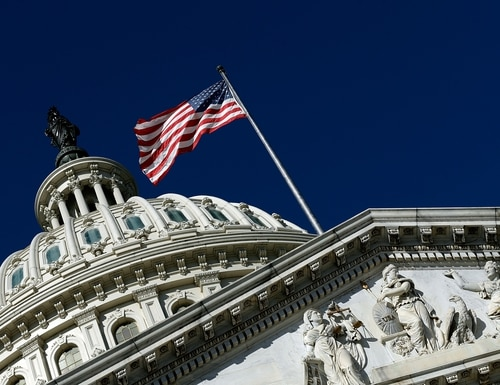 An American flag waves outside the United States Capitol building. (Photo by Win McNamee/Getty Images)