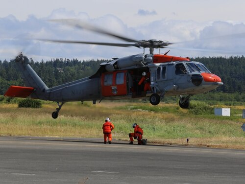 160625-N-DC740-177 OAK HARBOR, Wash. (June 25, 2016) Naval Air Station Whidbey Island's Search and Rescue team perform a demonstration during the base open house. The open house provides the general public an opportunity to interact with Sailors and learn more about NASWI's role both in the community and the Navy. (U.S. Navy photo by Mass Communication Specialist 2nd Class John Hetherington/Released)