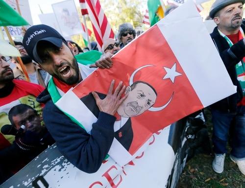 Protesters rally against the Washington visit of Turkish President Recep Tayyip Erdogan outside the White House, Wednesday, Nov. 13, 2019, in Washington. (Steve Helber/AP)