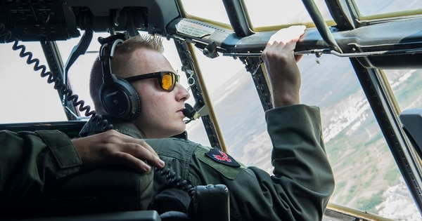 Capt. Dan Hill, a C-130J Super Hercules pilot with the 37th Airlift Squadron, looks out over Romania Aug. 21 during exercise Carpathian Fall 2019. The Air Force hopes it is turning a corner on retaining more pilots. (Staff Sgt. Kirby Turbak/Air Force)