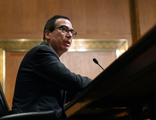 Department of Treasury Secretary Steven Mnuchin responded to concerns that federal employees and members of the military are required to participate in a new payroll tax deferral program. (Susan Walsh/AP)