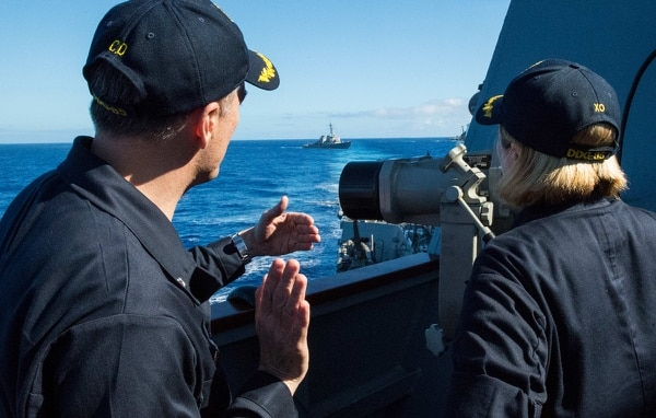 Cmdr. Ed Angelinas, left, commanding officer of the destroyer McCampbell), and Executive Officer Cmdr. Allison Christy perform group maneuvering exercises with ships from Destroyer Squadron 15. (Navy/MC2 Jeremy Graham)