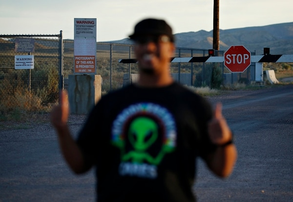 In this July 22, 2019, photo, Stan Evans poses as he has his picture taken while visiting an entrance to the Nevada Test and Training Range near Area 51 outside of Rachel, Nev. (John Locher/AP