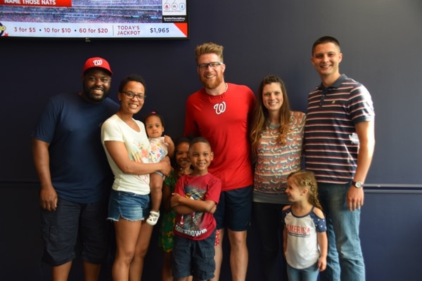 Washington Nationals closing pitcher Sean Doolittle meets the Motons and Rozmans. Both military families met the pitcher after his book reading with area military children. The event was part of the team's Nats on Base military community outreach program. (Kristine Froeba/Staff)