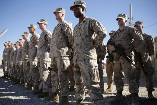 FILE - In this Jan. 15, 2018 file photo, U.S. Marines stand guard during the change of command ceremony at Task Force Southwest military field in Shorab military camp of Helmand province, Afghanistan. (AP Photo/Massoud Hossaini, File)