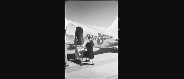 A woman holding a fur coat and sombrero boarding a Pan American-Grace Airways (Panagra) airplane heading to Buenos Aires, Argentina. Pan Am not only was a pioneer in international mail delivery but also passenger service that connected the globe. (Library of Congress)
