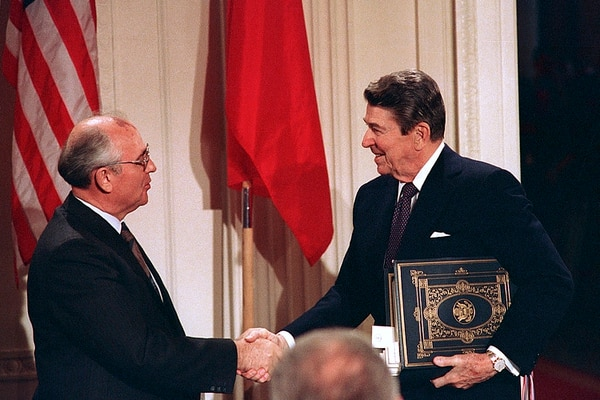 U.S. President Ronald Reagan, right, shakes hands with Soviet leader Mikhail Gorbachev on Dec. 8, 1987, after the two leaders signed the INF Treaty, which is now dead. Is the New START pact next? (Bob Daugherty/AP)