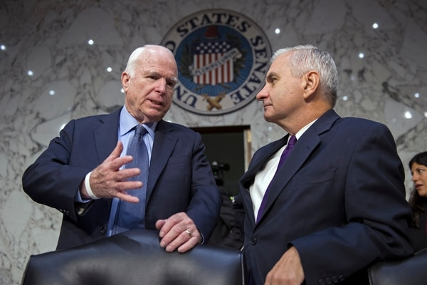 Senate Armed Services Committee Chairman Sen. John McCain, R-Ariz., left, talks with the committee's ranking member Sen. Jack Reed, D-R.I. on Capitol Hill in Washington, Thursday, Sept. 17, 2015, before the start of the committee's hearing on maritime security strategy in the Asia-Pacific region. (AP Photo/Cliff Owen)