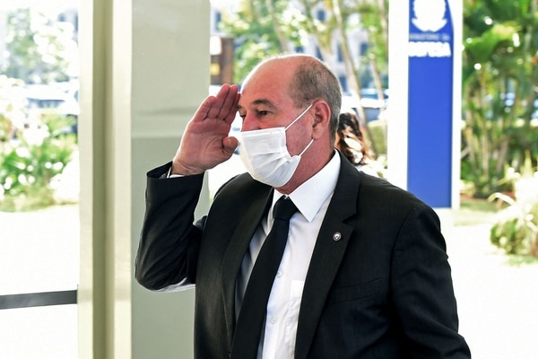 Former Brazilian Minister of Defense Fernando Azevedo e Silva salutes as he arrives at the Defense Ministry building in Brasilia, on March 30, 2021. Azevedo e Silva was dismissed by President Jair Bolsonaro in the ministerial reform carried out this week and will be replaced by the former Chief of Staff Braga Netto. (Evaristo Sa/AFP via Getty Images)