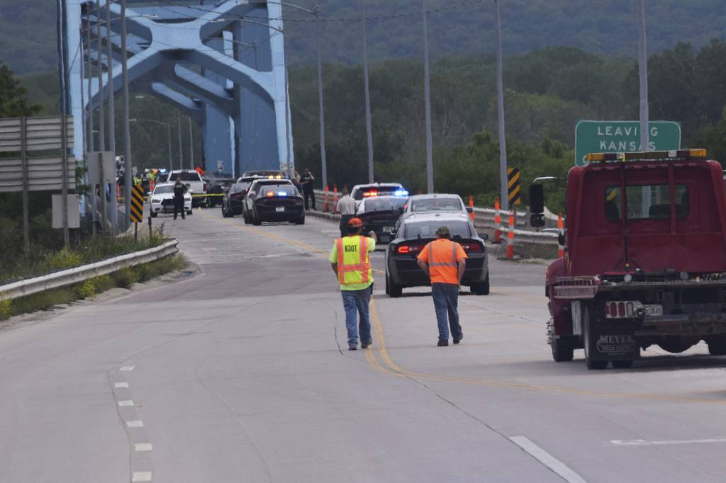 Authorities gather on Centennial Bridge after a shooting Wednesday, May 27, 2020, near Leavenworth, Kan.