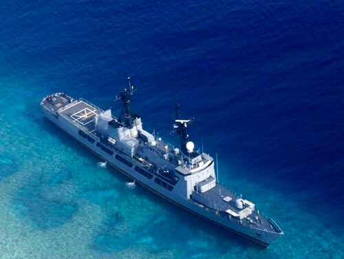 In this photo provided by the Armed Forces of the Philippines, the Philippine Navy ship BRP Gregorio del Pilar is seen after it ran aground during a routine patrol on Aug. 29, in the vicinity of Half Moon Shoal, which is called Hasa Hasa in the Philippines, off the disputed Spratlys Group of islands in the South China Sea. Philippine officials say they notified China about a navy frigate that ran aground near a hotly disputed area of the South China Sea in hopes of avoiding any misunderstandings. (Armed Forces of the Philippines via AP)