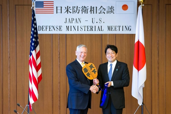U.S. Defense Secretary Jim Mattis, left, and Japanese Defense Minister Itsunori Onodera, pose with