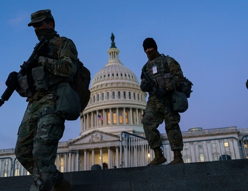 National Guard troops reinforce the security zone on Capitol Hill in Washington, Tuesday, Jan. 19, 2021, before President-elect Joe Biden is sworn in as the 46th president on Wednesday. (J. Scott Applewhite/AP)