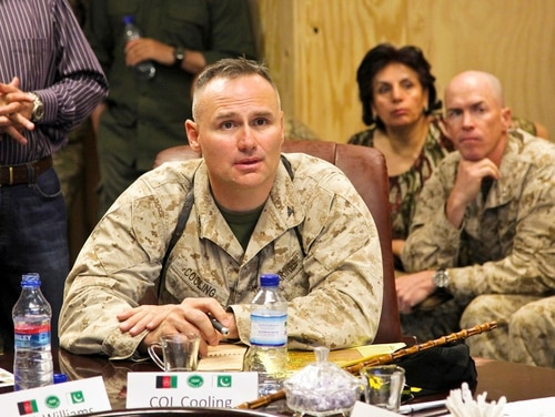 Marine Corps Col. Norman Cooling, G-3, Regional Command South West, speak to members of International Security Assistance Force, Afghanistan, and Pakistan military officials at the Joint Border Coordination Center for a border flag meeting at Forward Operating Base, Spin Boldak, Kandahar province, Afghanistan, June 21, 2011. (Sgt. Joseph Johnson/DoD)