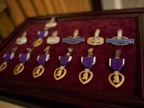 Washington, UNITED STATES: Purple Heart medals are seen before a presentation ceremony at the Walter Reed Army Medical Center 06 April 2007 in Washington, DC. The Purple Heart is awarded to those killed or wounded in action while serving with the US military. AFP PHOTO/Mandel NGAN (Photo credit should read MANDEL NGAN/AFP/Getty Images)