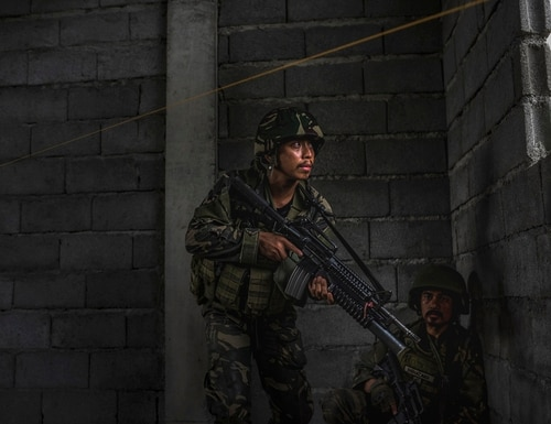 Three Philippine soldiers were killed and 12 wounded in the
