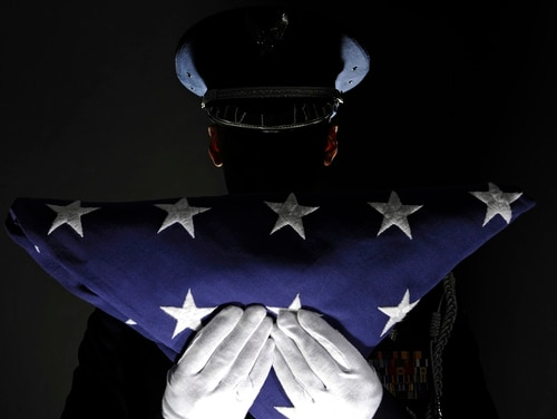 Staff Sgt. James Grotjan died July 12, 2018, at Landstuhl Regional Medical Center in Germany after being injured in a non-combat-related incident July 8 in United Arab Emirates. Pictured: A member of the Ellsworth AFB Honor Guard stands at attention after completing the flag dressing sequence. (Staff Sgt. Marc I. Lane/Air Force)